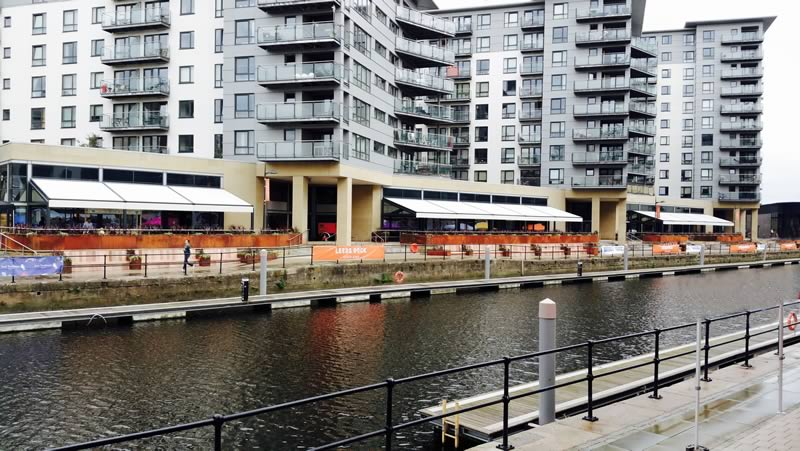 Wide view of commercial retractable awnings for Leeds Dock 3